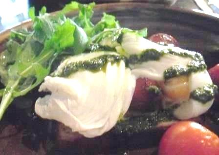 Two before Ten breakfast of poached eggs, balsamic tomatoes, and pesto dressing
