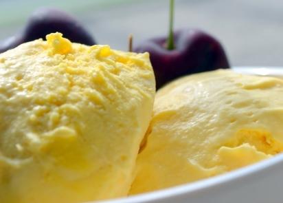 Home-made mango ice-cream with black cherries