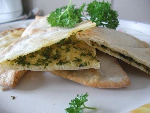 Garlic and parsley infused pita pocket (flatbread)