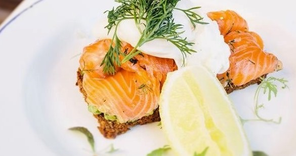Smoked salmon and poached eggs with smashed avocado on toast