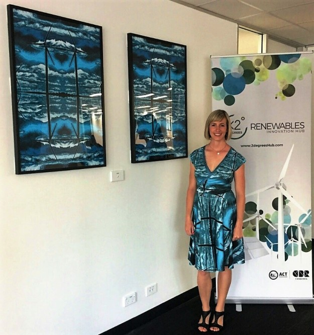 Yumi Morrissey with her wind turbine print at the ACT Government Renewalables Hub opening