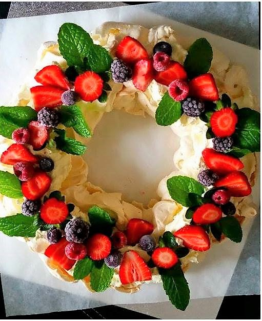 Christmas wreath pavlova with berries and holly
